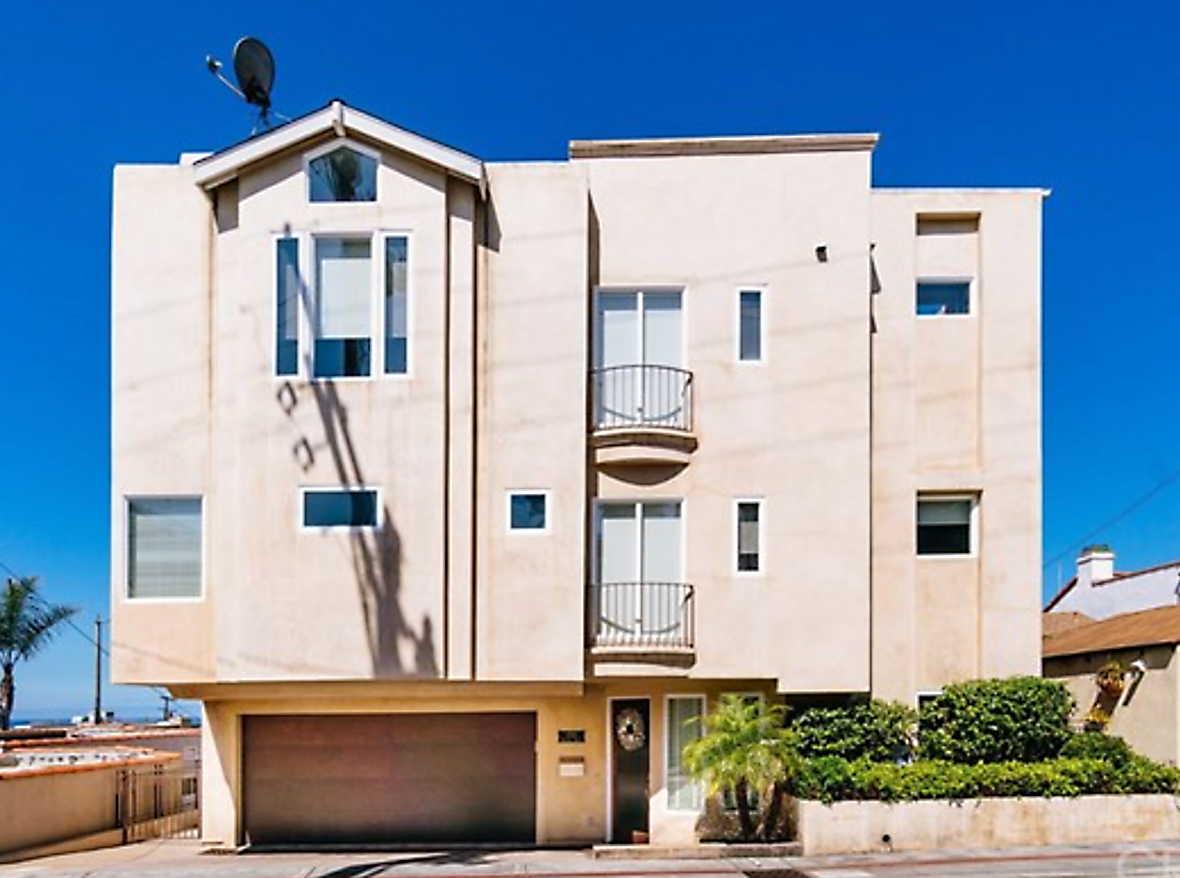 "Built on a wide 50' lot, this townhome offers large rooms and baths with breathtaking views from PV to Malibu from three levels! Eat breakfast on the spacious deck off the living room while watching the waves hit the Pier, or spot whales on the roof top deck with two distinct living areas. Inside, you'll quickly notice updates including all new paint, hardwood floors, custom wainscoting, wood shutters and Minka fans. The chef's kitchen includes granite counters, a Thermador cooktop, Bosch dishwasher, and wine refrigerator. The oversized master suite, complete with custom mahogany walk-in closet. The spa-like master bath has a large glass shower, distinct ""his and hers"" sinks and storage, complete with large soaking and jetted tub. A second bedroom and en-suite bath are also located on the second level. The winding stairs take you to the broad and welcoming foyer, a fully redone 3rd large bedroom, another full bath, and direct access to a roomy two car garage with custom built-in storage. A skylight floods all three levels with natural light, and highlights the open floor plan from foyer to roof. Audiophiles will appreciate the surround sound built through out. This oasis is arguably the best location in Hermosa Beach. A prime North-of-Pier location."
