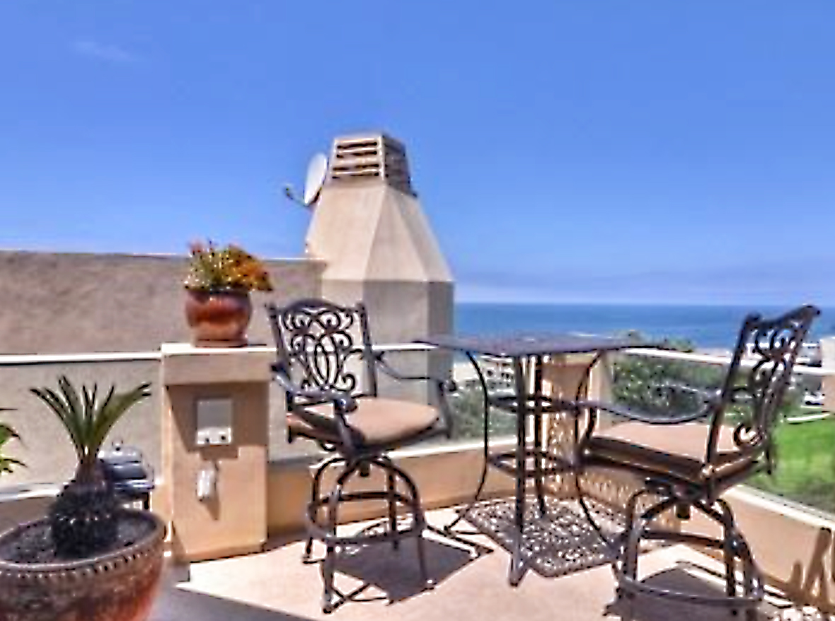 "his stunning 3/bed + 3.5/bath Mediterranean styled townhouse is perched on the top of the hill over looking the Pacific Ocean & the Santa Monica mountains. Down 3 steps to the lower level is the 1st bedroom w/ a double door entry & closet w/ custom shelving. The bathroom for this bedroom is across the hall with Travertine throughout. Up on the main floor of the home is the 2nd bedroom w/ attached bathroom, attached balcony, & tons of natural sunlight. Also on this level is the master suite w/ large walk-in closet, tons of windows, & balcony looking northwest at the ocean & mountains. The en suite features a dual vanity, Jacuzzi tub, glass shower, & separate water closet. The upper level of this home is the ""cherry on top!"" The second you crest the stairs you are greeted w/ spectacular views of the Pacific Ocean in the west to the Santa Monica Mountains in the north. This amazing view is what this entire floor was designed around. From the dining area to the kitchen w/ its wrap around granite counter tops all facing the ocean. The living room with built-in surround & fireplace opens up to the large balcony, the ideal place for taking in some sun or just relaxing while listening to the waves crash on the shoreline."