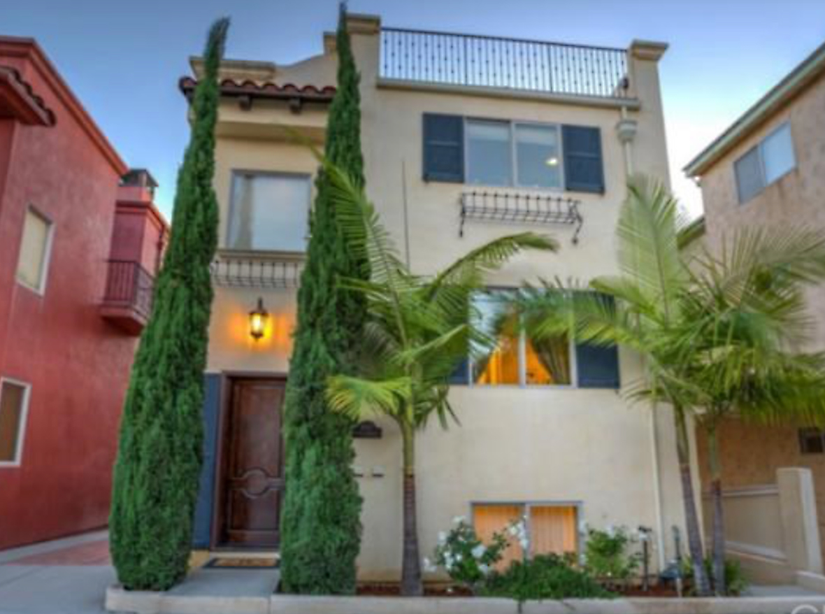 Meticulously maintained mediterranean town home, which is built on one of the highest points in Hermosa Beach—with an ocean view roof deck, and a large patio connected to the third floor, main living space. This is one of the best values and most desirable detached town homes available in the beach cities today. The property includes a true chef's kitchen featuring top-of-the-line KitchenAid stainless appliances with a 36-inch built-in refrigerator, double convection ovens and warming drawer. The kitchen also has loads of storage, a large center island, walk-in pantry and granite countertops throughout. The home features a reverse floor plan with kitchen, great room and an ocean view private office on the third level. The flooring is lightly distressed Brazilian Cherry hardwood, and the lower levels feature thick wall-to-wall carpet. For complete comfort control, there's central air conditioning and Milguard triple-glazed windows for the ultimate in thermal efficiency—keep the home at the temperature you like most. Quality build features include Crema Marfil marble and top-quality fixtures and materials throughout. This home is perfect for families and singles, plus the roof deck offers some of most wonderful ocean and coastline views around.