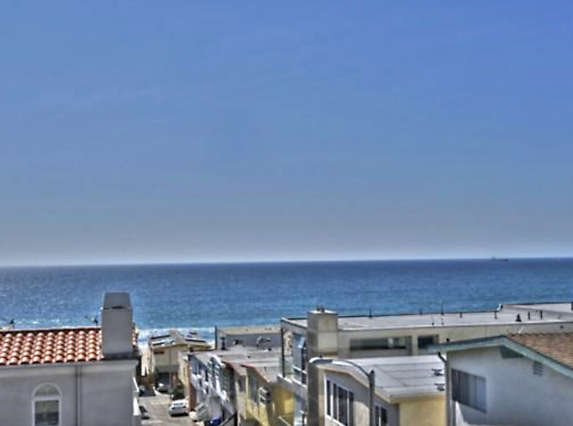 Beautiful, detached town home just steps to the sand with sweeping ocean and Malibu views. Walnut floors throughout; three bedrooms, each with their own bath; gorgeous kitchen with granite counters; all stainless steel appliances; living room with fireplace and large deck. Immaculate 2 car garage; plus additional carport. Great location, within walking distance to downtown; and a quick drive to LAX.