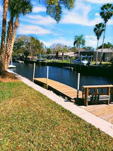 Welcome home! This is a large 4/2 waterfront home with a dock & boat lift. The home comes fully furnished. When you walk in, there is a really nice formal dining room & living room. The kitchen has an open concept with an island & large bar top for extra seating as well as a large walk-in pantry. There is an additional dining space situated in the Florida room that is very nice & bright with lots of light coming in from the beautiful waterfront view!! Just off of the kitchen there is the main living room with a sectional couch, flat screen TV & in the next room over you will find a game room with a ping pong table. Come & relax for a summer vacation or stay long term. Rents for $3000.00 per month or $1500.00 per week plus tax. Pets considered with deposit. Call to see this one today! (Any rental reservations for less than six months & one day have 11% short term tax)
