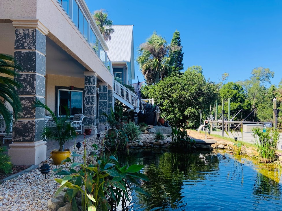 "Welcome to ""Waterfall Springs"" of Crystal River, FL! This is an excellent waterfront unit that has everything to make your stay extra enjoyable. Outside there is a dock space available for your use, covered patio with seating, grill & a beautiful koi pond. Inside the unit is completely furnished & also features indoor laundry, large shower, full kitchen, adjustable beds, pull out queen sofa, pool table, 75"" TV with cable / wifi, 2 kayaks, a paddle board, board games, corn hole. The room is one large space that is open to the living & kitchen area. There is enough room to sleep up to four guests comfortably. This is a two story home & the owners live upstairs in the main part of the home & guests will have full access to the downstairs area with their own private entrance. Any rental reservations for less than six months & one day have 11% short term tax. One small dog allowed with pet fee or deposit but must follow breed restrictions."
