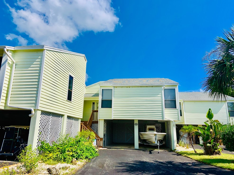 Excellent 2/2 fully furnished condo in a gated community comes with a boat dock, community pool, tennis court & club house! This location is close to the Ft Island Trail beach & close to town. Condo comes with all furnishings, sheets, towels & kitchen supplies to make your stay more comfortable. WiFi, basic cable, water & electric included with a cap of $200.00. There is a three month minimum stay required due to the HOA. Any rental reservations for less than six months & one day have 11% short term tax. Move-in requirements: Credit/background check.