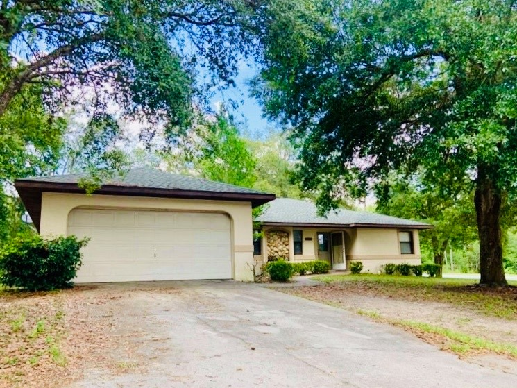 Available Soon! This beautiful two bedroom, two bath home is located in Citrus Springs on a corner lot. This home is very spacious with a HUGE living and dining room. Comes equipped with a large screened-in lanai, and many shade trees. Available soon & with new photos!