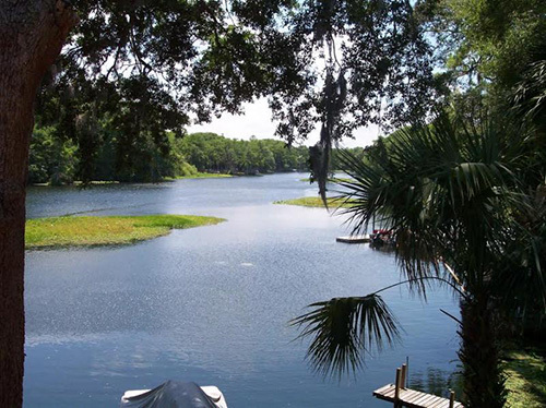 Bring your boat, trailer, and fishing poles to this waterfront rental property in Dunnellon, Florida; THE BASS CAPITOL OF THE WORLD!  View the beautiful Rainbow River and Withlacoochee River from the HIGHEST point on the river. This property is also located right down the street from biking trails. It's the perfect location for the outdoorsman or anyone who wants a real Florida experience. Rent this 2 Bedroom, 2 bath, condo located right on the water in the downtown Dunnellon area at the confluence of the beautiful Rainbow River and Withlacoochee River. This Dunnellon rental is close to the Gulf of Mexico, shopping, great restaurants and activities. Will rent for $1650 with up to $150 cap on the electric included! Don't miss out on this one of a kind rental.