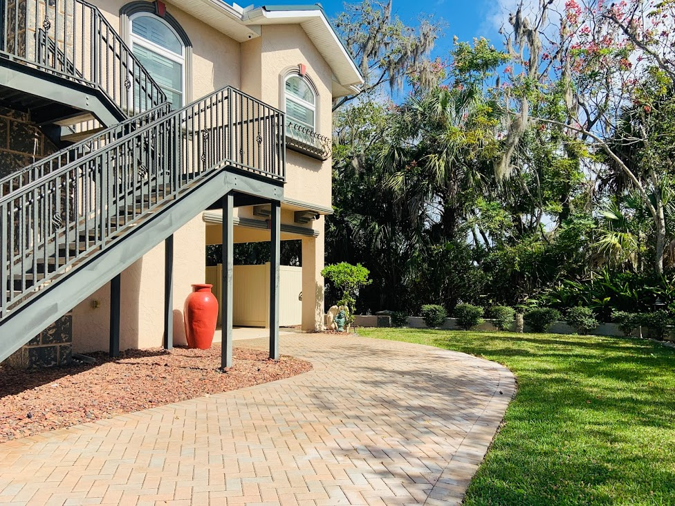 """Welcome to """"Waterfall Springs"""" of Crystal River, FL! This is an excellent waterfront unit that has everything to make your stay extra enjoyable. Outside there is a dock space available for your use, covered patio with seating, grill & a beautiful koi pond. Inside the unit is completely furnished & also features indoor laundry, large shower, full kitchen, adjustable beds, pull out queen sofa, pool table, 75"""" TV with cable / wifi, 2 kayaks, a paddle board, board games, corn hole. The room is one large space that is open to the living & kitchen area. There is enough room to sleep up to four guests comfortably. This is a two story home & the owners live upstairs in the main part of the home & guests will have full access to the downstairs area with their own private entrance."""