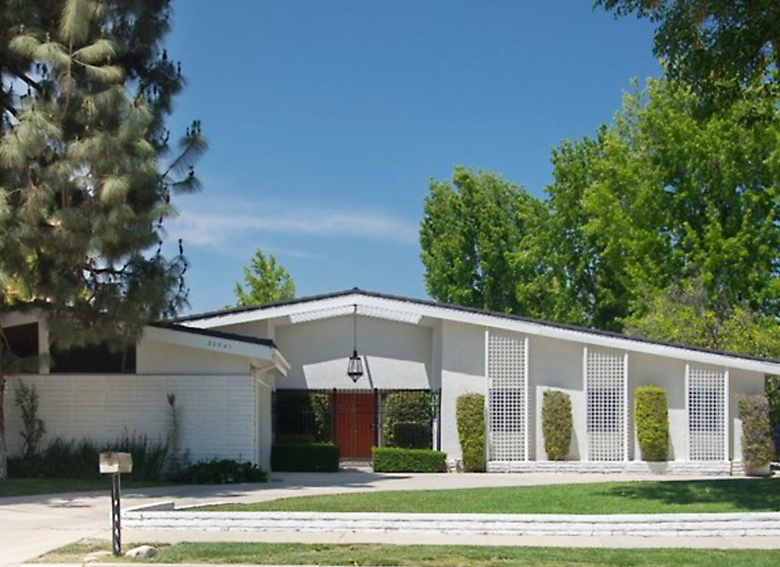 Classic single story mid-century home in Woodland Hills Woodford Manor. The circular driveway and corner lot location welcome you to this 4 bedroom 3 bath home. The expansive terrazzo entryway leads you to the bedroom wing on the right, living areas to the left and courtyard and yard straight ahead. The living room has sliding glass doors to the back yard and is open to the formal dining area. The kitchen has been remodeled and features a subzero refrigerator freezer and a breakfast area and desk. The service porch has a Miele washer dryer, a full bath and leads to the garage. There's also a classic paneled den, and most of the windows have been replaced with internal blind double panes. The master suite has a sliding glass door to the yard, walk in & sliding door closet and separate tub and shower. The three additional bedrooms share a full bathroom. This trust sale requires no court confirmation, but this was an original owner home so it is looking for the buyer who wants to do what is necessary to make this classic their own.