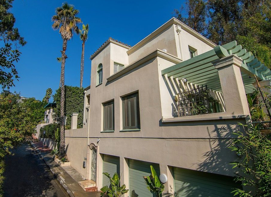 Wide stairway entrance that leads to open floor plan with limestone floors. Living room opens out to private pool with views. Kitchen w/ granite countertops & commercial appliances. Walk-in closets with sky lighting. A huge master w/ private terrace and views. A master bath w/ tub & walk-through shower. Very private. Great sec. system w/ cameras. The perfect home for entertaining or showcasing one's art collection. Open and airy with lots of light throughout the day. A must see!