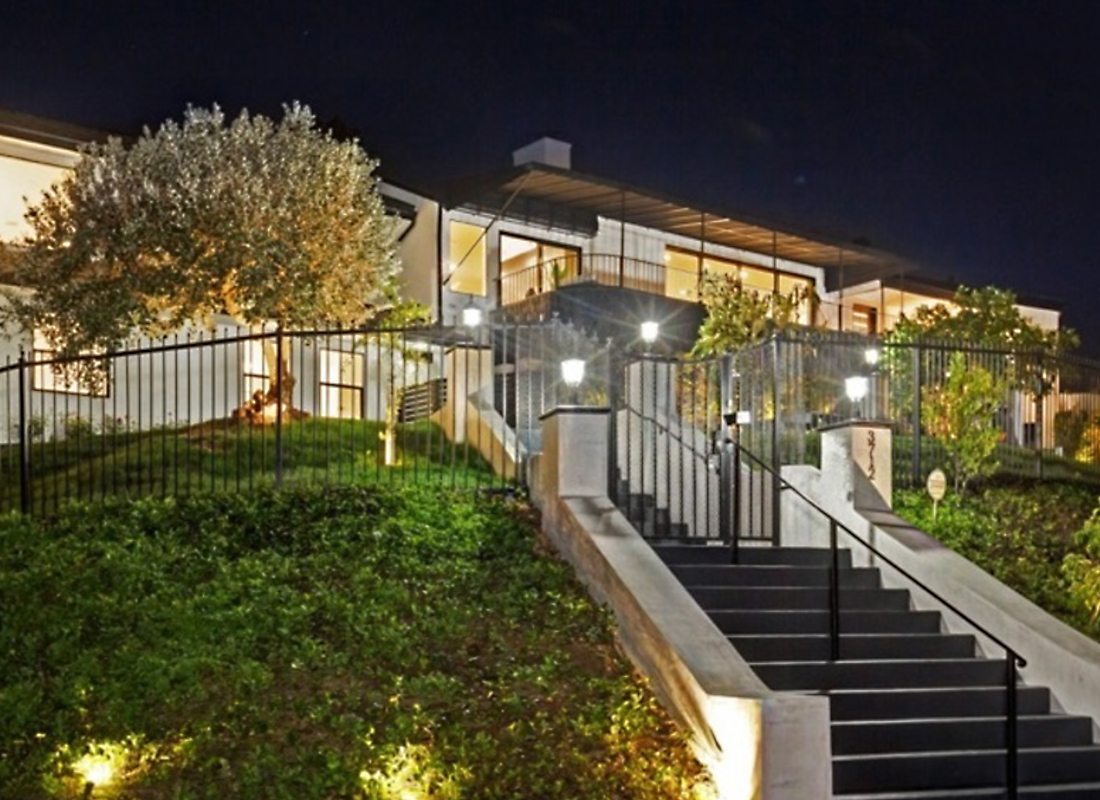 Nested in the Hills, sits this luxurious panoramic view home with a graceful Contemporary modern design. Airy & light-filled, the interior draws you in with wide open entertainment spaces that flow effortlessly from inside to out. Corner lot property sitting high above the street affords the utmost privacy while providing spectacular views from almost every room. An exquisite almost brand-new remodel boasting sleek new finishes, glass walls of vanishing Milgard pocket doors & new systems. An open & spacious layout that exudes intimacy predominately sitting on 1 level. Large secluded backyard-wonderful retreat with a huge heated swimmers pool. Garage has an oversized door that fits an RV or boat. An incredibly spacious & private entertainment area surrounds the built-in BBQ outdoor kitchen. Thermador appliances grace the gourmet kitchen with center island seating. The 5 bdrms consist of 4 en-suite bdrms with 2 grand master suites & an entire lower level bdrm having a separate entrance.