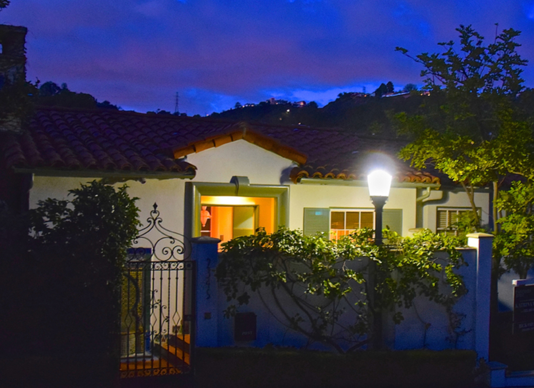 Elegant Hollywood Hills Spanish c. 1946. This Mediterranean beauty sits poised to enjoy views from every room. Features include a gracious formal living and dining room, an extensively remodeled cook's kitchen, a spacious master suite starring a relaxing bath with enviable views, steam shower and French doors opening to it's own private patio. There are 2 additional bedrooms ~ both en suite, gleaming wood floors and period built-ins. This home has a walled courtyard entry, direct access garage and multiple patio areas with space for entertaining. Enjoy a cool night in the hot tub or dinner el fresco. Welcome home to Old Hollywood Romance.