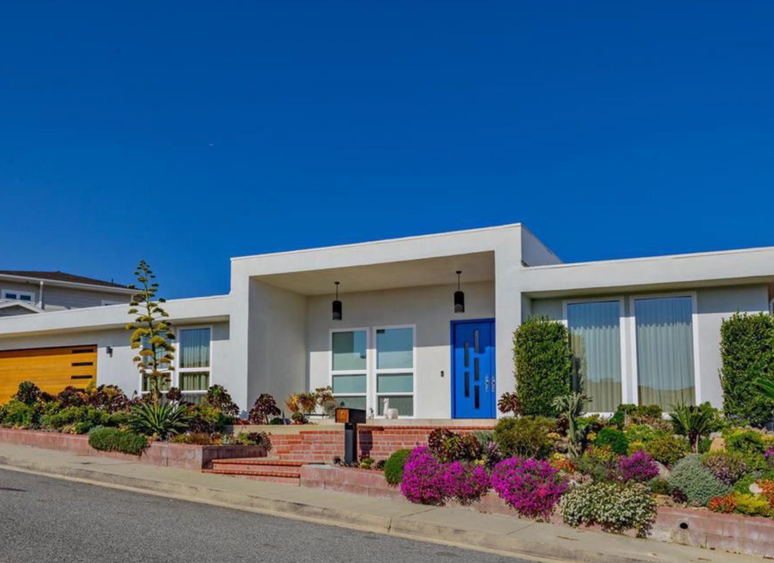 Gorgeous mid-century modern contemporary home. Impressive entryway leads into an open floor plan of 3,876 square feet. Single story, dramatic floor to ceiling windows, large open living and dining space, beautiful matted mahogany wood floors throughout, recessed lighting combined with custom fixtures, powder bathroom has stunning jade glass tile wall, 4 spacious en-suite bedrooms with plenty of closet space. Master Suite is a private oasis complete with sliders leading to pool and beautiful valley views, master bathroom has floating tub, rainfall shower, double vanity, and walk-in closet that is sure to keep anyone organized. Family style chef kitchen has cherry wood cabinets, granite counters, and stainless steel appliances opens to family room and bar area with beautiful stacked flagstone fireplace. All this and more surrounded by large pool backyard with grassy area and Views Views Views! Two car attached garage has direct access and plenty of parking. This property is a true entertaining and family size home with LA chic style!