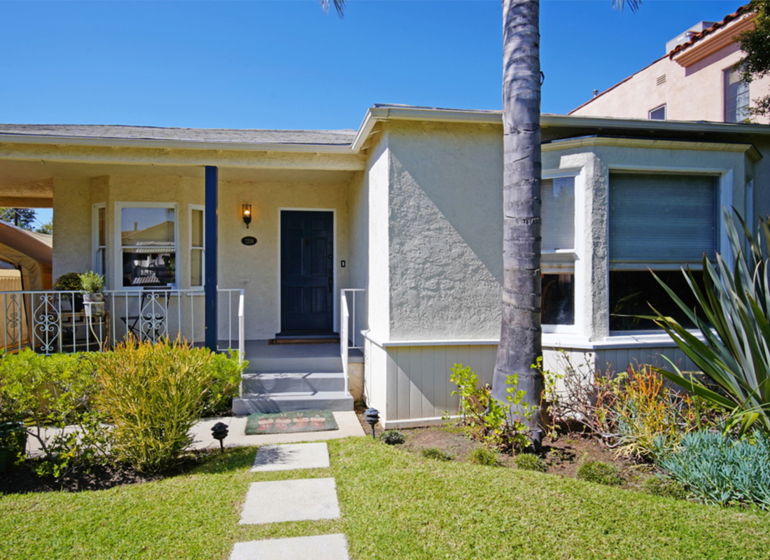 Welcome to your private beautifully appointed, fully updated 1 level home with a charming front porch and a nice large back yard with room to add an ADU or garage conversion. TANKLESS hot water heater and Ring door bell. Featuring gorgeous chocolate hardwood floors a large living room with warming fireplace and a beautiful dining room for big family dinners. The kitchen has custom white cabinetry, stainless steel appliances and a nice breakfast area. There is a Large master suite with a lovely master bathroom featuring a huge JACUZZI bathtub and separate shower fit for a queen. 2 large additional bedrooms share a bathroom and one of the bedrooms in the rear of this lovely home has french doors opening out to a nice elevated deck, perfect for outdoor dining. Located in close proximity to all of LA's best restaurants and shopping.