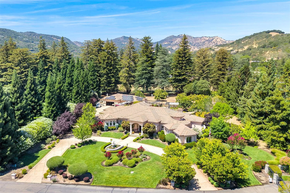 Exquisite estate on 2.18 level acres in private gated community. One story 5,115 sq. ft. custom-built home with 4 bedrooms (2 master suites), 3 full and two 1/2 bathrooms, office, chef's kitchen w/ high-end appliances, home theater, wine room, private courtyard w/spa. This sprawling property offers a total of 9,395 sq. ft. under roof which includes the main house, attached 3 car garage, a detached 2,224 sq. ft. workshop w/heater, car lift, room for four cars, adjoining 3-car garage with  bath, office and storage rooms. Also included under roof is a spacious veranda and a 660 sq. ft. outdoor cabana with a BBQ, fireplace, TV, refrigerator, sink and ice maker. The backyard is a gardener's delight with a 13x20 greenhouse and raised vegetable garden. Additional benefits are a back-up Generator, owned Solar, LED lighting inside & out, RV parking with full hookups, low $75/mo HOA fee and more! Please visit our website and video at www.4279valleyln.com