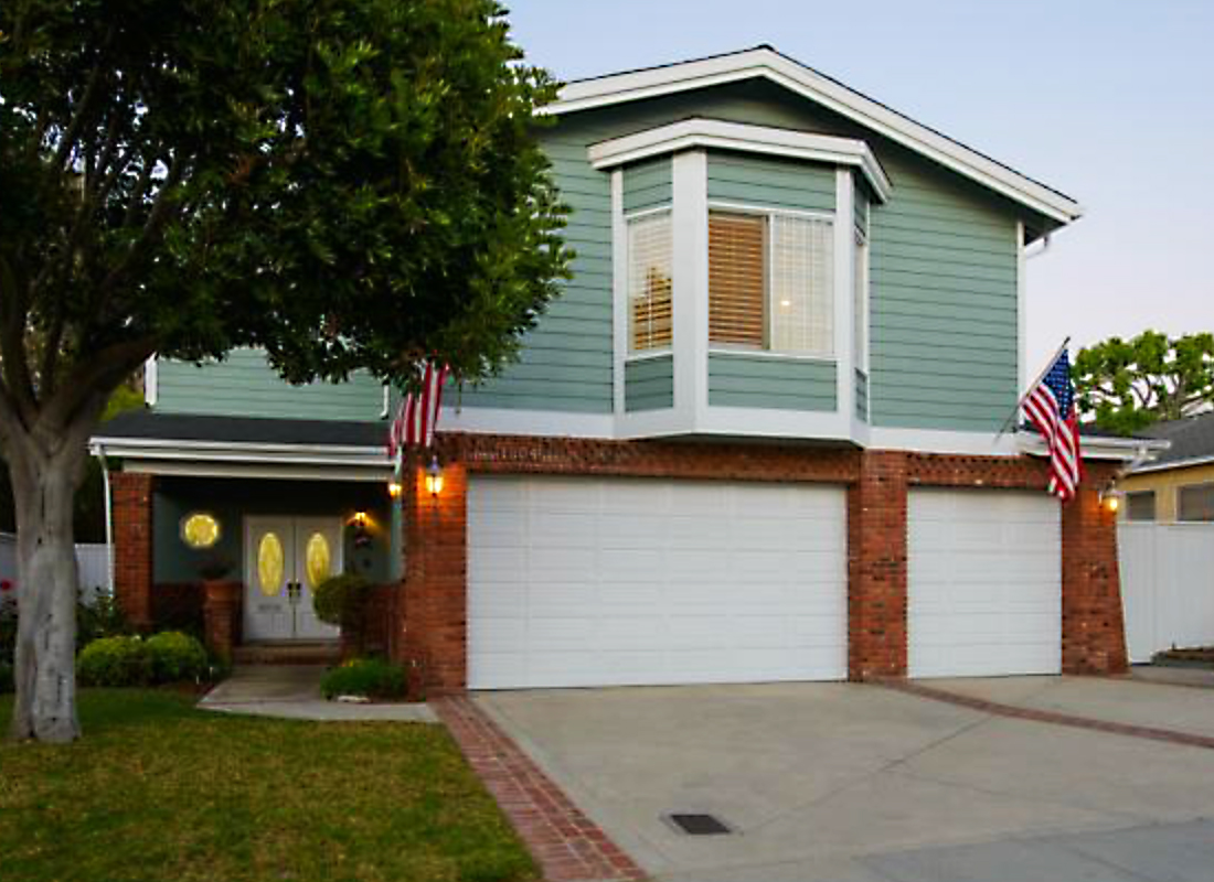 True Family and Entertaining Home. With over 3300 square feet there is room for everyone! Freshly painted inside and out, the curb appeal alone will invite you in. 4 large bedrooms, 3 full bathrooms, eat in area & separate formal dining room, 2 enormous living rooms both with gorgeous fireplaces and vaulted ceilings. The bright kitchen opens to a large eat-in area, a living room with a stunning brick fireplace & bar nook and has french doors opening to the patio leading down to the lovely back yard. 3 bedrooms are on the bottom level as is a separate laundry room with a sink. The three car garage provides ample parking. This wonderful home is close to the school and park. Welcome home!