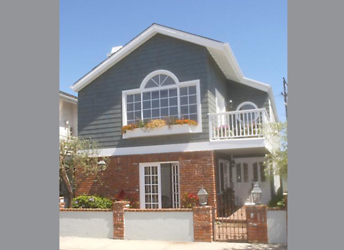 This spacious, bright, open, clean home is 2295 square feet of good living space on a flat 30 X 80 lot in the North Hermosa Sand Section. 3 LARGE bedrooms, 2 1/2 bathrooms, soothing and neutral Martha Stewart colors. The newer custom kitchen offers high ceilings, stainless appliances and granite counter tops. 3 sets of French doors open to balconies or the patio garden. Custom designed stone fireplace, imported Italian wrought iron banister, and extra built-in storage in the garage to hide your wine collection, ski's, boards or tools - are some highlights. Best of all, you are only 4 short blocks to the sand! Come see, it's very nice!