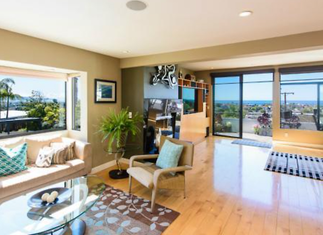 Resort Style Living Every Day...Panoramic ocean view condo at 736 Gould #8 in Hermosa Beach. Arguably, the best unit with the best views in the complex, this is the Southern end unit of the 8 with attached garages. Upgrades of hard wood floors, granite counters, and recessed lighting complement this warm contemporary condo. The best feature is the background blue Pacific Ocean seen through all of the windows as you walk into the living area. Open floor plan offers a wet bar, 2 living rooms, dining room, kitchen and access to patio ALL flooded with natural light & ALL with ocean views. The master suite & patio upstairs invite you to sit as though you are on top of the world. There is a second bedroom, office, separate laundry, pool, spa, social space, guest parking - all available for use. You must SEA it to believe it.