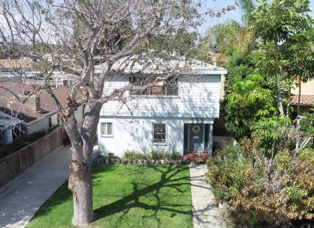 Opportunity is knocking! Street to alley 40 x 135 lot. Yup, that's a large one: 5400'. Remodel or tear down and build what you have been dreaming about: Mother-in-law quarters above the garage? Outdoor fire pit surrounded by built in living room? Basement with a bar and theater? You name it. Existing structures includes a 2-story 3 bed/2 bath home plus a detached garage with a bonus room and bathroom. The location is on a flat lot only 5 blocks to the beach, a quick walk or bike ride to Grandview, and a super quick ride to LAX.