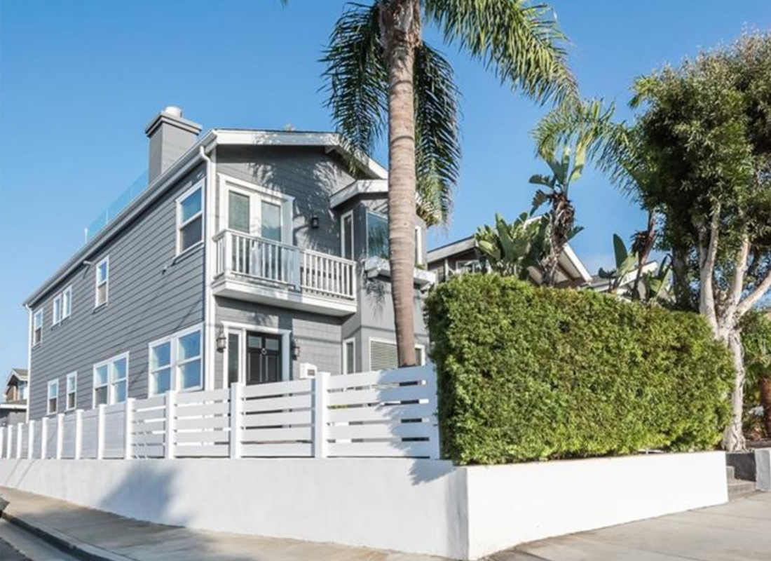 "Rare, warm, contemporary remodeled home located on a corner lot with amazing ocean view roof deck. A privacy hedge & new white fence greets you as you walk through the child friendly front yard. Open the door to this happy & graceful 3 bed, 3 bath home w/ ~ 2000 sq ft. Custom floors & A+ upgrades (AC!) are part of the ""WOW"" factor! The living room features an inviting window seat, a refaced fireplace & a wall of large windows for amazing natural light. The dining area focal point is a large drop down pendant hovering over a farm table. The kitchen w/ all newer appliances has a huge walk in pantry, breakfast bar & opens to a new custom-built office/study space, w/ a Dutch door to a back patio, w/ grill & built-in casual bench seating. One bed & remodeled bath are on the lower level. Upstairs features a large master suite w/ vaulted ceilings, window seat, refaced fireplace, walk-in closet & gorgeous remodeled bath, both with ocean peeks. Upstairs laundry room has ample linen storage. The third bedroom is large w/ vaulted ceilings & ocean peek. Another flight up is an amazing roof deck w/ a new glass protective perimeter. Choose the bar stool perch or the built-in couches to photograph your favorite sunset. The detached garage is located on 20th place w/a side storage area. Side street parking & back home entrance are key on this corner lot. This family friendly neighborhood is a few blocks to schools, parks, dining, shopping & only a 10 min walk to Hermosa Pier."