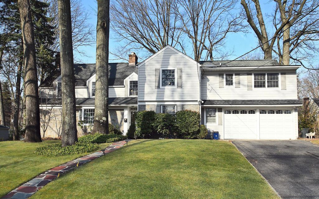 Beautifully expanded Colonial style home situated on one of Tenafly's most sought after East Hill tree lined streets & only minutes' walking distance to Smith Elementary school, houses of worship, the JCC & NYC buses. A beautiful large great room with skylights, wood-burning fireplace & French doors.  1st Fl, large family rm, dining rm, powder rm & mud rm. Anderson sliders off the eat-in Kitchen to the backyard patio. The 2nd Fl features a large Master suite, generously sized 2BDR suites, and another 2BRs for a total of 5BDR/3bths. Finished bsmt w/windows, high ceilings, a large rec rm, fbth w/shower,finished room, 2yr old washer/dryer, laundry/storage rm.  3 skylights on the recently painted 2nd Fl make this house very bright even on cloudy winter days. Hardwood floors throughout most of the 2nd FL with new carpet in the stairway, hallway and one BDR. Many updates within the last few years, roof, hot water tanks and more...one of the best offerings in Tenafly.