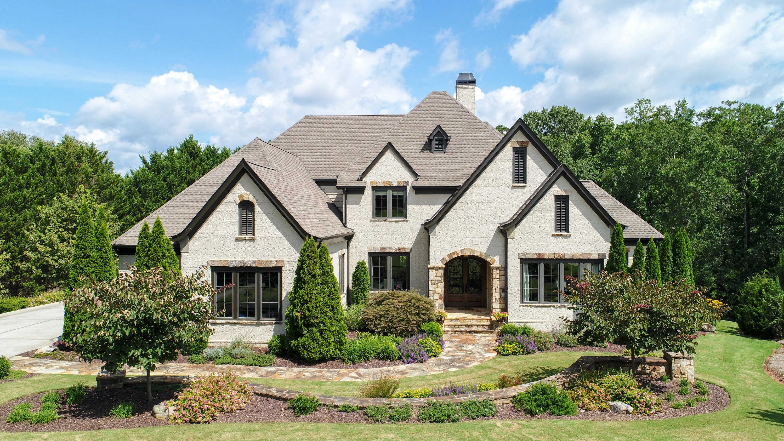 Every once in a while an amazing, masterfully built home becomes available to have a new owner.  This is one of the finest homes ever built on Lake Lanier.  Enjoy living just 2 blocks from the Chattahoochee Country Club.  Fine details & finishes, brick & stone exterior, 3 garages, saltwater, pebble tec, heated pool, spa, home theater, 4 fireplaces, covered decks & patios, boat dock w/party deck, terrace lvl bar/kitchen, & whole house & outdoor music system. 2nd flr wetbar. Enjoy waking up to heated floors & lake views in the main level owner's suite everyday.