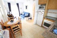 South-Facing Top Floor Apartment with Solarium + Pool Views!  (1)