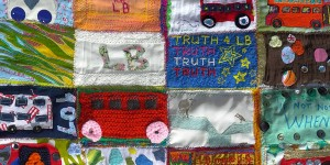 A section of the large quilt in memory of LB (Connor Sparrowhawk known as LB - 'Laughing Boy' online) with patches submitted by supporters of the #JusticeforLB campaign.