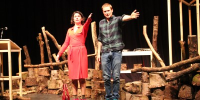 Kat and Alister from Two Destination Language are on the wooden set of their show Manpower, bowing