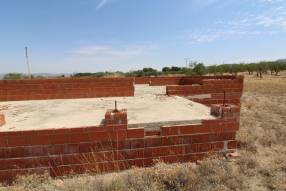 Land of 10,287m2 with foundations and permits to build your own home (2)