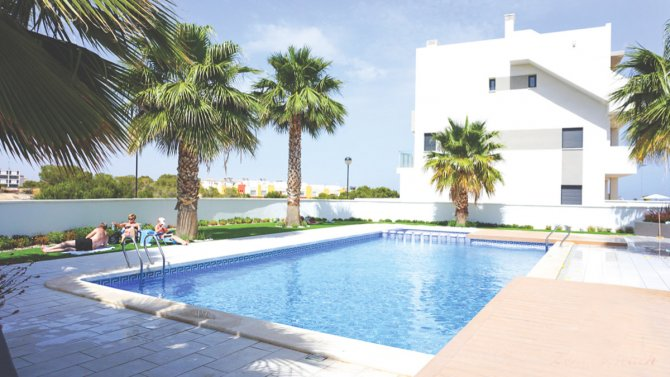 3 bed 2 bath penthouse apartments with large solarium and communal pool in La Zenia Beach II
