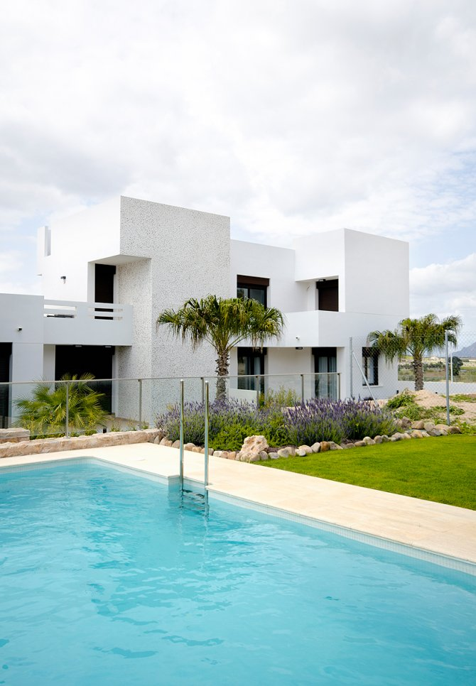 3 bed 2 bath townhouses with communal pool superbly situated overlooking the prestigious La Finca Golf course