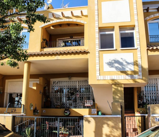 Ground floor apartment with private solarium and communal pool in lovely village