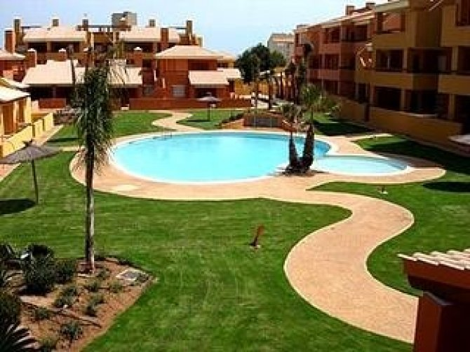 500 metres from the beach! 2 bed apartments with communal pool, gardens, sports area and water-sports club
