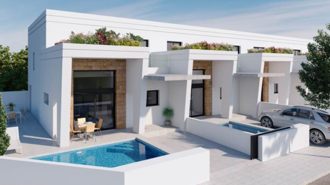 Townhouses with private pool located in bustling Spanish town