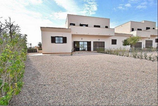 Luxury linked villas with 2 communal pools and garden in Hacienda del Alamo golf resort