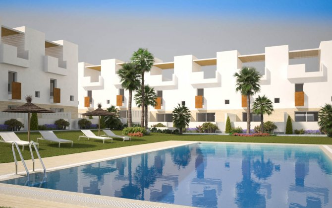 Modern townhouses with communal pool walkable to the beach