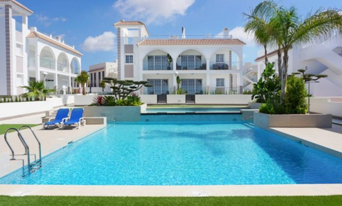 Stunning luxury properties with communal pool within walking distance to shops, bars and restaurants
