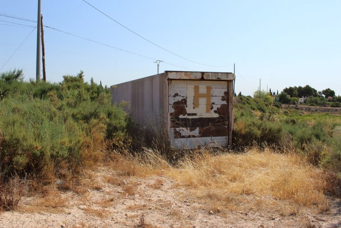 Land for Sale good location including large storage trailer.