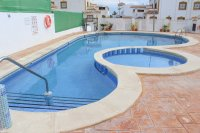 South west facing Quad townhouse with communal pool on popular golf resort  (1)