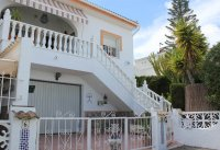 Well-presented, semi-detached villa with large garden and garage