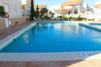 Semi-detached villa with community pool and off-road parking in very popular area  (1)