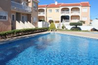Well-presented, first floor apartment with solarium and community pool in Doña Pepa (0)