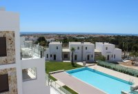 3 bed/2 bath modern style semi-detached townhouses with communal pool and solarium with spectacular sea views (10)
