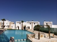 3 bed/2 bath modern style semi-detached townhouses with communal pool and solarium with spectacular sea views (9)