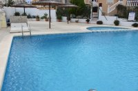 Well-presented, blue top quad, one level, with communal pool in popular area (1)