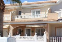 Well-presented townhouse overlooking lovely community pool in Doña Pepa (0)