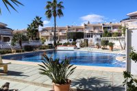 Well-presented townhouse overlooking lovely community pool in Doña Pepa (1)