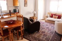 Well-presented apartment with private parking & communal pool in popular village (4)