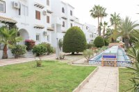 Well maintained ground floor apartment  with large communal pool, (13)