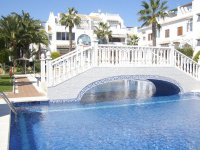 Well maintained ground floor apartment  with large communal pool, (14)
