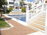 Well maintained ground floor apartment  with large communal pool, (15)